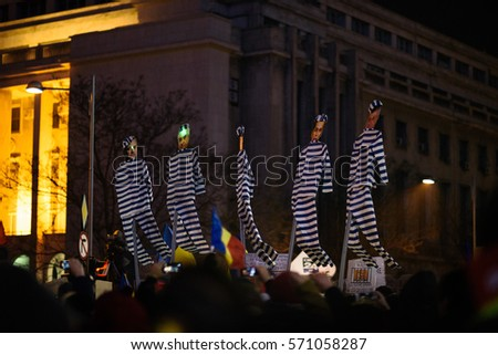 Bucharest, Romania - February 3 2017: Thousand people marched through the Romanian capital on friday night to protest the government's plan to pardon thousands of prisoners. #571058287