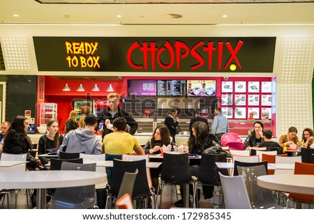 BUCHAREST ROMANIA JANUARY 24 People buying chinese food from Chopstix Restaurant on January 24 2014 in Bucharest Romania Chopstix is one of the main chinese food restaurant chain in Romania