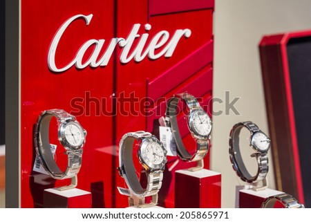 BUCHAREST, ROMANIA - JULY 18, 2014: Cartier Watches In Shop Window Display. Founded in Paris in 1847 it designs, manufactures, distributes and sells jewellery and watches.