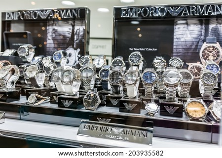 BUCHAREST, ROMANIA - JULY 08, 2014: Giorgio Armani Watches In Shop Window Display. Is an Italian fashion house founded by Giorgio Armani, which designs leather goods, shoes, watches and jewelry.