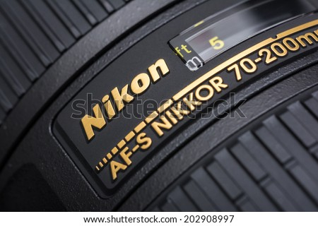 BUCHAREST, ROMANIA - JULY 05, 2014: Nikon 70-200 f/2.8 Lens For Digital Single Lens Reflex Camera. Founded in 1917 is a Japanese multinational corporation specializing in optics and imaging products.