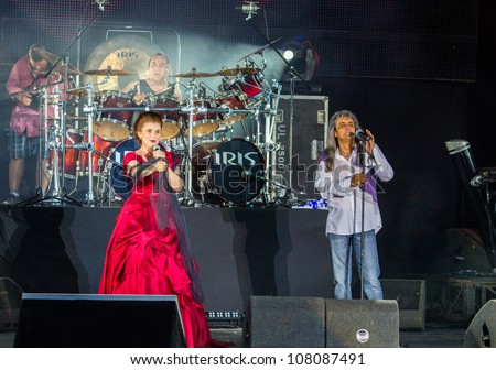 BUCHAREST, ROMANIA - JUN 22: Felicia Filip, Cristi Minculescu and his band Iris performs on stage at Constitutiei Square on Jun 22, 2012 in Bucharest, Romania