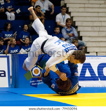 BUCHAREST, ROMANIA - JUNE 4: Contestants participate in the Judo World Cup Men 2011 on June 4, 2011, Bucharest, Romania - stock photo