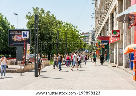 BUCHAREST, ROMANIA - JUNE 09, 2014: Crowd Of Busy People Going To Work In Piata Unirii (Unification Square) Of Bucharest. It is one of the largest squares in central Bucharest.