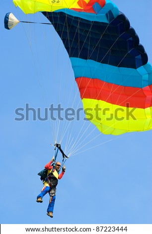 BUCHAREST, ROMANIA - JUNE 4: Paratroopers from National Skydiving Club perform at Transilv Aero Show 2011 in Clinceni on June 4, 2011 on Bucharest, Romania