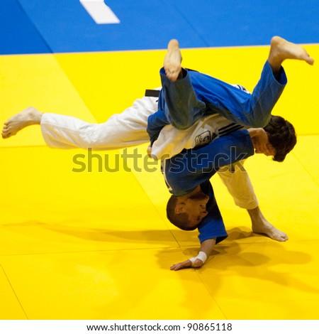 BUCHAREST, ROMANIA - JUNE 4: Unidentified contestants participate in the Judo World Cup Men 2011 on June 4, 2011, Bucharest, Romania