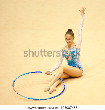 BUCHAREST, ROMANIA - JUNE 17: Unidentified  gymnast performs during the Irina Deleanu Orange Trophy on June 17, 2012, Bucharest, Romania