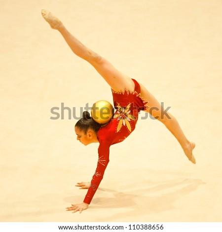 BUCHAREST, ROMANIA - JUNE 17: Unknown gymnast performs during the Irina Deleanu Orange Trophy on June 17, 2012, Bucharest, Romania
