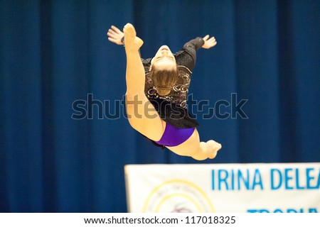 BUCHAREST, ROMANIA - JUNE 17: Unknown gymnast performs during the Irina Deleanu Orange Trophy on June 17, 2012, Bucharest, Romania