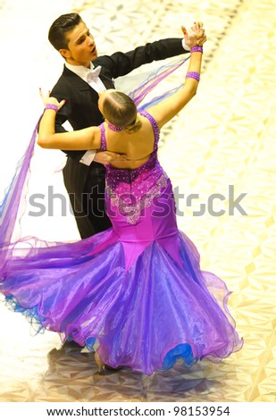 BUCHAREST, ROMANIA - MARCH 18: An unidentified dance couple in a dance pose at Ten Dance Championship, March 18, 2012 in Bucharest, Romania