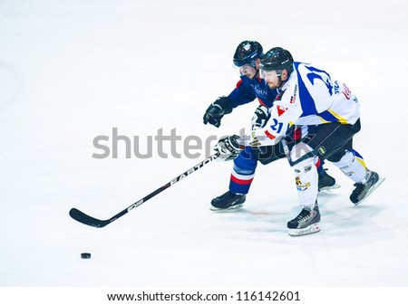 BUCHAREST, ROMANIA - MARCH 11: Unidentified hockey players compete during the Steaua Rangers(blue) vs Corona Brasov(white) game Flamaropol Stadium, score 6-3, on March 11 , 2012 in Bucharest, Romania