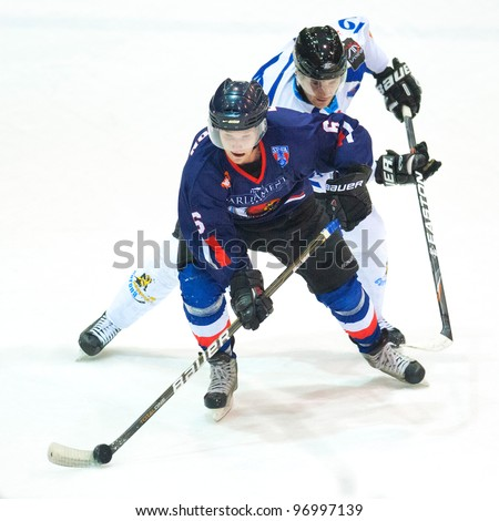 BUCHAREST, ROMANIA - MARCH 2: Unidentified hockey players compete during the Steaua Rangers vs Corona Brasovl game at Flamaropol Stadium, score 3-2, on March 2 , 2012 in Bucharest, Romania