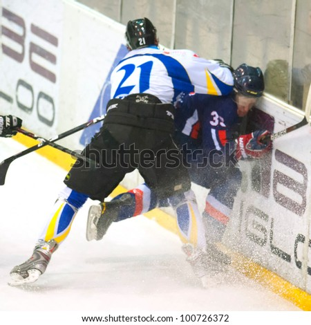 BUCHAREST, ROMANIA - MARCH 2: Unidentified hockey players fight during the Steaua Rangers vs Corona Brasovl game at Flamaropol Stadium, score 3-2, on March 2 , 2012 in Bucharest, Romania