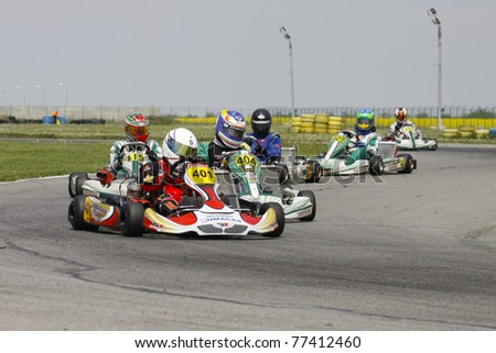 BUCHAREST, ROMANIA - MAY 8: David Dugaesescu, number 401 competes in South East European Karting Zone Championship on MAY 9, 2011 in Bucharest, Romania.