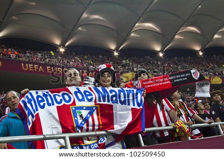 BUCHAREST, ROMANIA - MAY 9, 2012: Fans supporting their team at Europa league final game. Club Atletico de Madrid's wins UEFA Europa League on May 9, 2012 in Bucharest, Romania.