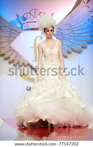 BUCHAREST, ROMANIA - MAY 7: Fashion model wears clothes from Magic Woman collection, in Bucharest Fashion Week at World Trade Center on May 7, 2011 in Bucharest, Romania