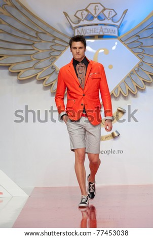 BUCHAREST, ROMANIA - MAY 7: Fashion model wears clothes made by Ego Men's Fashion in Bucharest Fashion Week at World Trade Center on May 7, 2011 in Bucharest, Romania