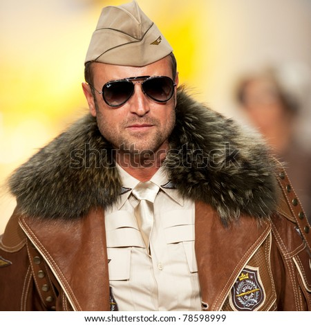 BUCHAREST, ROMANIA - MAY 7: The designer Catalin Botezatu wear chlotes from his Aviator collection, in Bucharest Fashion Week at World Trade Center on May 7, 2011, Bucharest, Romania