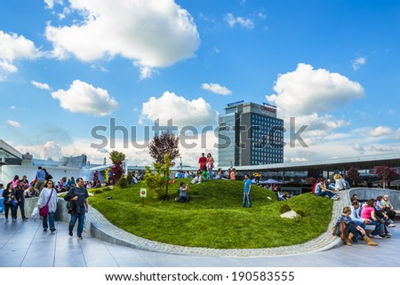 BUCHAREST, ROMANIA - MAY 1: Unidentified people relax at recreation area in Promenada Mall on May 1, 2014 in Bucharest, Romania. The mall received Building of the Year SEE 2014 at CEEQA Gala, Warsaw.