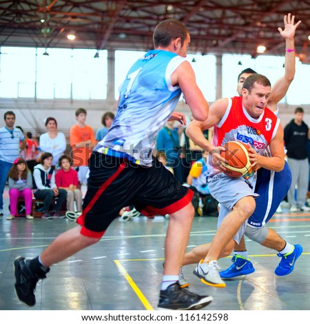 BUCHAREST, ROMANIA - MAY 20: Unknown basketball players perform during the game Sport Arena Streetball 3x3, Play On (red) vs. Tiki Taka Polit (blue) on May 20, 2012 in Bucharest, Romania