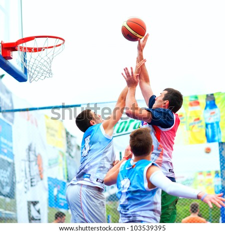 BUCHAREST, ROMANIA - MAY 20: Unknown basketball  players performs during the game Sport Arena Streetball 3x3, Play On (red) vs. Tiki Taka Polit (blue) on May 20, 2012 in Bucharest, Romania