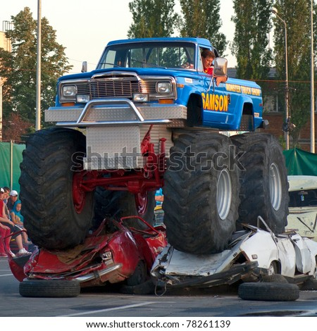 BUCHAREST, ROMANIA - MAY 29: Unknown driver entertains the crowds in his monster truck at ''Stunt Cars Show'' on May 29, 2011 in Bucharest, Romania