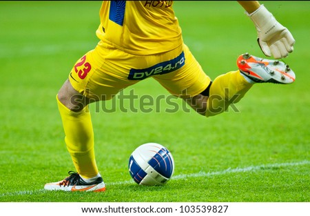 BUCHAREST, ROMANIA - MAY 23: Unknown football player performs during the soccer game Romanian Cup Timisoareana, Dinamo Bucharest (red) vs. Rapid Bucharest (black) on May 23, 2012 in Bucharest, Romania