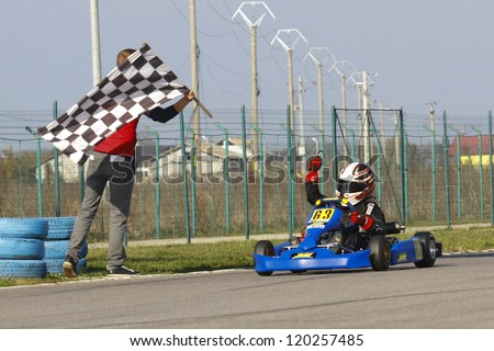 BUCHAREST, ROMANIA - NOV. 11: Alex Dina, number 63, competes in Karting Cup Romania, on november 11, 2012 in Bucharest, Romania.