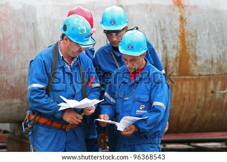BUCHAREST, ROMANIA - NOV 9: Oil workers perform maintenance duties at the Arpechim refinery near Pitesti; on Nov 9, 2007 some 120 kilometers from Bucharest, Romania.