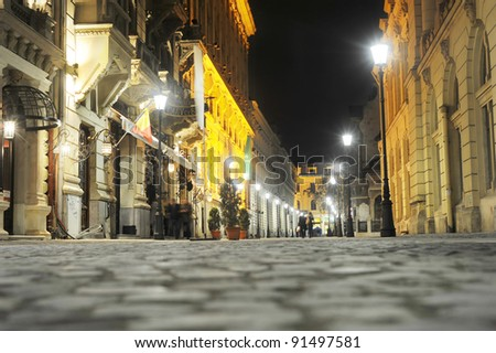 BUCHAREST, ROMANIA - NOVEMBER 06: Old City of Bucharest in the night on November 6, 2011 in Bucharest, Romania.The area is historic for this is where Bucharest was founded in the 1300s. - stock photo