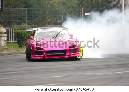 BUCHAREST,ROMANIA-OCT. 22 : Brad Hacker ldrives a Mazda FD RX7 at Drift Grand Prix of Romania on October 22, 2011 in Bucharest, Romania