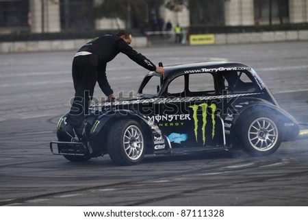 BUCHAREST, ROMANIA - OCT 21: Terry Grant drifting demonstration at Drift Garnd Prix of Romania Contest in Bucharest. Oct 21, 2011, Bucharest, Romania - stock photo
