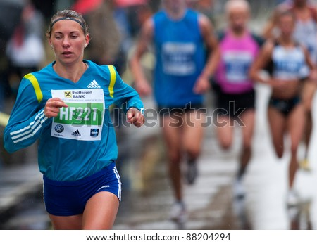 BUCHAREST, ROMANIA - OCTOBER 8: An unidentified marathon runner competes at the Bucharest International Marathon 2011, October 8, 2011 in Bucharest, Romania