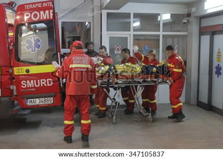 Bucharest, Romania, October 31, 2015: Romanian paramedics transfer a wounded person, who survived from a fire at Colectiv Club from the Emergency Hospital Floreasca to a burn center.