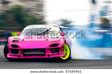 BUCHAREST, ROMANIA - OCTOBER 23: Unidentified driver participates in a drifting demonstration at Drift Garnd Prix of Romania Contest in Bucharest on October 23, 2011 Bucharest, Romania