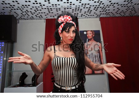 BUCHAREST, ROMANIA - SEPT 15: Merante Tamar van Amersfoort, official replica of singer Amy Winehouse, perform a concert at the event of reopening of a club in Bucharest, Saturday, August 15, 2012