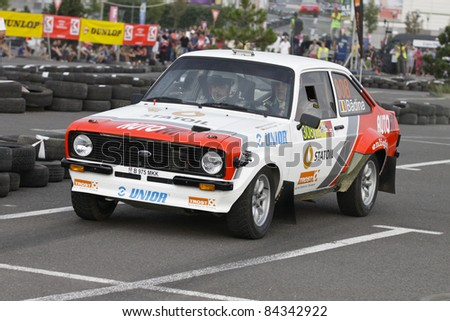 BUCHAREST, ROMANIA - SEPTEMBER 02: Badina Eugen drives a Ford Escort Mk2 car during Rally of Romania 2011 Championship, on September 02, 2011, in BUCHAREST, ROMANIA. - stock photo