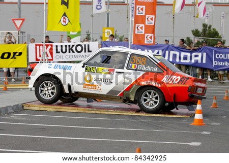BUCHAREST, ROMANIA - SEPTEMBER 02: Badina Eugen drives a Ford Escort Mk2 car during Rally of Romania 2011 Championship, on September 02, 2011, in BUCHAREST, ROMANIA.
