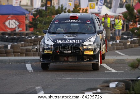 BUCHAREST, ROMANIA - SEPTEMBER 02: Edwin Keleti drives a Mitsubishi Lancer EVo car during Rally of Romania 2011 championship, on September 02, 2011 in Bucharest, Romania.