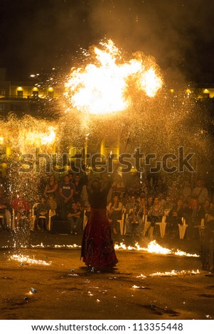 BUCHAREST, ROMANIA - SEPTEMBER 13: Lara Castiglioni performs Neige de Feu show during B-FIT in the Street, International Street Theater Festival on  September 13, 2012 in Bucharest, Romania.