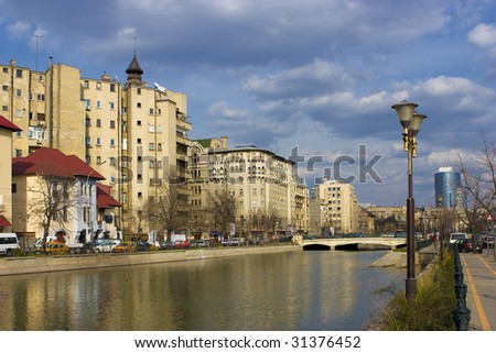 Bucharest - view over Dambovita river in a clear spring day. Can be used for postcards, brochures and other layouts - stock photo