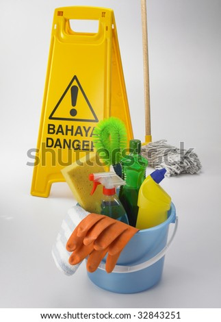 bucket full of the house hold cleaning equipment
