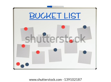 Bucket list with empty papers and magnets on a whiteboard, isolated on white