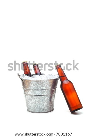 Bucket of Beer with one bottle leaning on bucket isolated over white with slight shadow