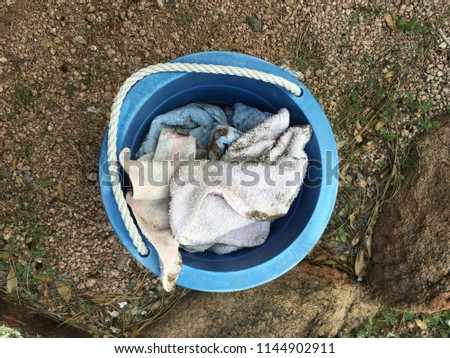 Bucket of Dirty Rags on the Ground