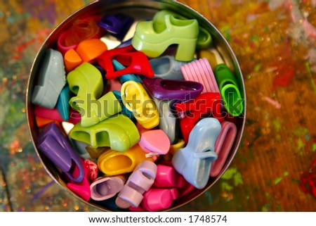 Bucket of doll shoes - find the one you want