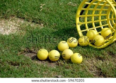 bucket of driving range golf balls