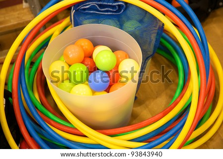 Bucket of plastic balls and some colorful hula hoops