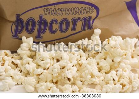 Bucket of popcorn on white background.