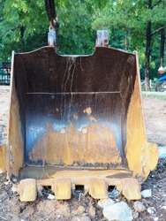 Bucket of Trackho on ground